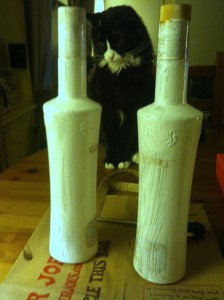 painted bottles with helper cat